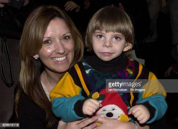 Aid worker Sarah Kermish from Hampshire meets a young child during a visit to a Moscow community centre as part of Operation Christmas Child the...