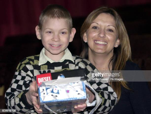 Aid worker Sarah Kermish from Hampshire meets young orphan Igor during a visit to Moscow's Orphanage No28 for the Mentally Impaired as part of...