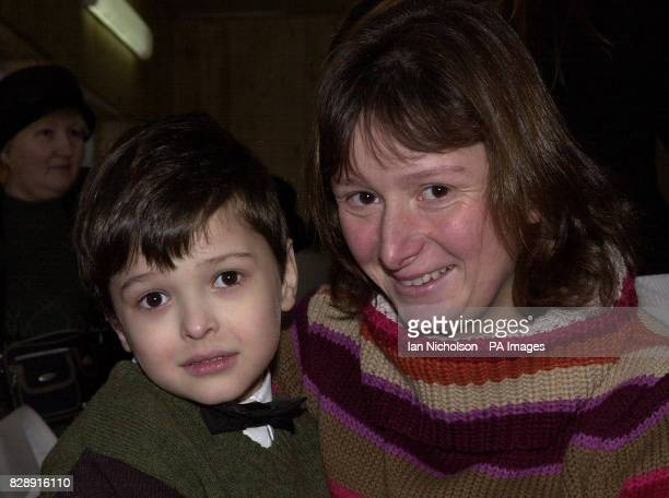 Aid worker Sharon Hedges from Warwickshire meets a young child during a visit to a Moscow community centre as part of Operation Christmas Child the...