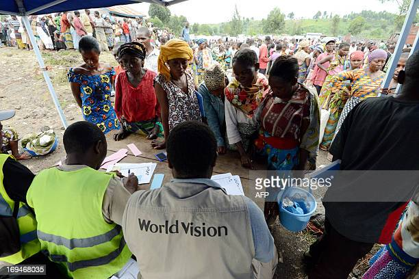 Aid workers register Internally Displaced People during a food distribution program at an IDP camp in Mugunga 15km outside of Goma on May 25 2013 The...