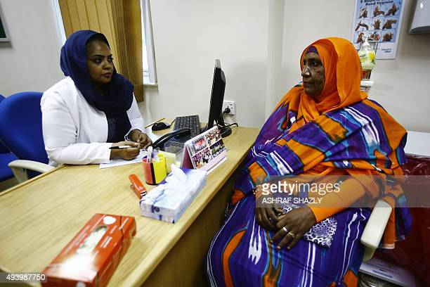 Aida Abdulla speaks Dr Samrin Farouk Habbani at the Khartoum Breast Care Centre on October 15 2015 Local doctors told Abdulla her chest pain was an...