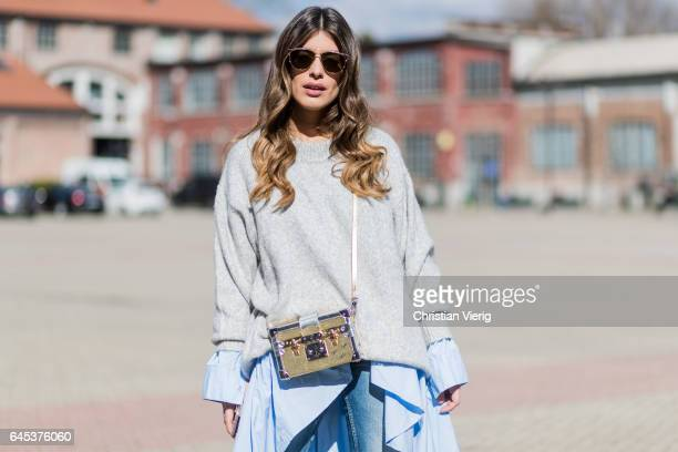 Aida Domenech wearing a grey knit ripped denim jeans outside Missoni during Milan Fashion Week Fall/Winter 2017/18 on February 25 2017 in Milan Italy