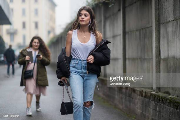 Aida Domenech wearing ripped denim jeans fishnet tights outside Diesel during Milan Fashion Week Fall/Winter 2017/18 on February 24 2017 in Milan...