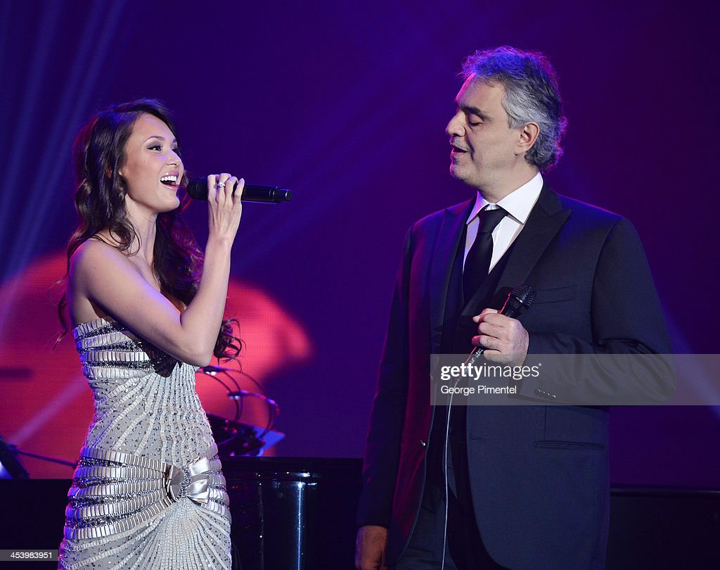 Aida Garifullina and opera singer <a gi-track='captionPersonalityLinkClicked' href=/galleries/search?phrase=Andrea+Bocelli&family=editorial&specificpeople=211558 ng-click='$event.stopPropagation()'>Andrea Bocelli</a> perform at the David Foster Foundation Benefit Concert at Allstream Centre on December 5, 2013 in Toronto, Canada.