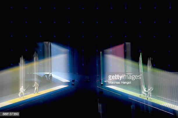 Aida Shanaeva of Russia and Hee Sook Jeon of Korea and Nzingha Prescod of the United States and Astrid Guyart of France compete during the women's...