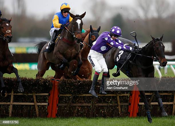 Aidan Coleman riding Acajou Des Bieffes is unseated from his mount as they approach the first flight of hurdles in The bet365 Novices' Hurdle Race at...