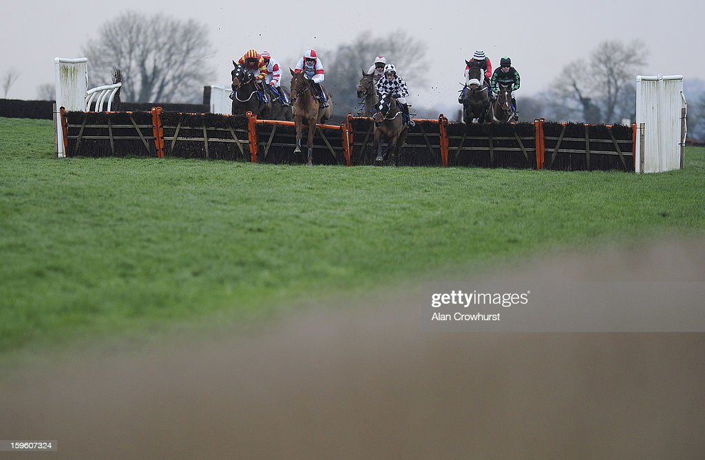 Aidan Coleman riding Brick Red (C, red/blue) on their way to winning The Higos Insurance Dervices Langport Handicap Hurdle Race at Wincanton racecourse on January 17, 2013 in Wincanton, England.