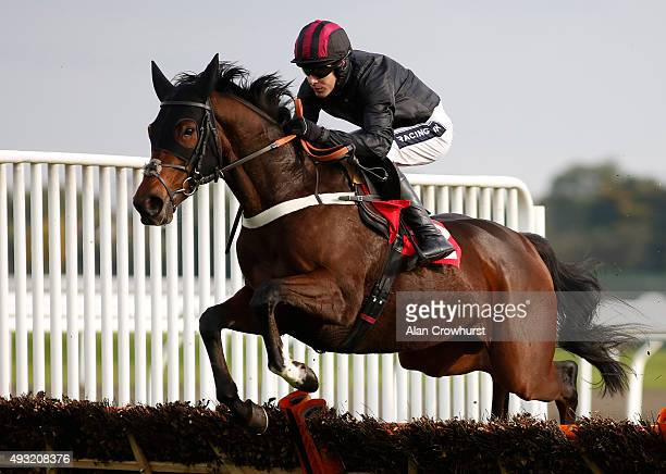 Aidan Coleman riding Maputo on their way to winning The William Hill On Your Mobile Novices' Hurdle Race at Kempton Park racecourse on October 18...