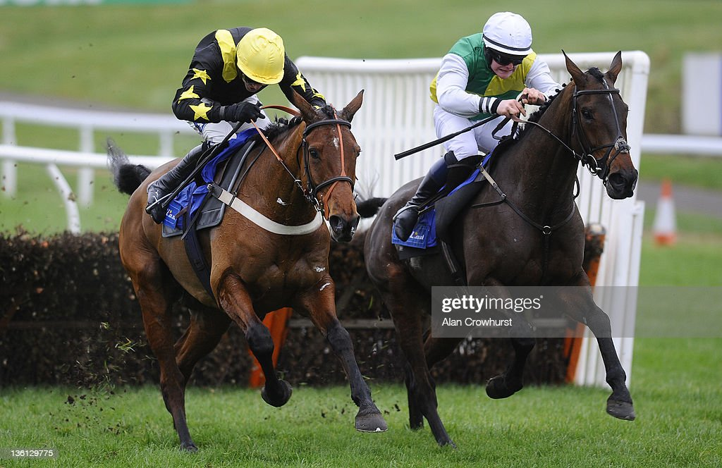 Aidan Coleman riding Rev It Up (L) and Maurice Linehan riding Palace Jester (R) clear the last to dead heat in The Bet In Play Now At coral.co.uk Handicap Hurdle Race at Chepstow racecourse on December 27, 2011 in Chepstow, Wales.