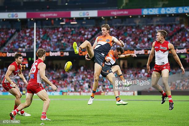 Aidan Corr and Josh Kelly of the Giants competes for the ball during the round three AFL match between the Sydney Swans and the Greater Western...