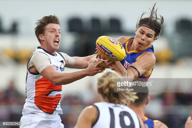 Aidan Corr of the Giants and Eric Hipwood of the Lions compete for the ball during the round 14 AFL match between the Brisbane Lions and the Greater...