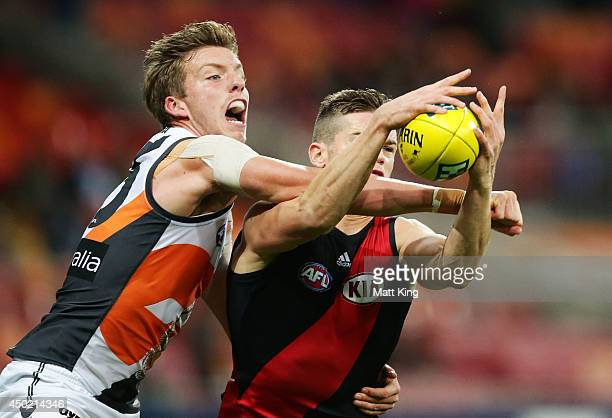 Aidan Corr of the Giants competes for the ball against Patrick Ambrose of the Bombers during the round 12 AFL match between the Greater Western...