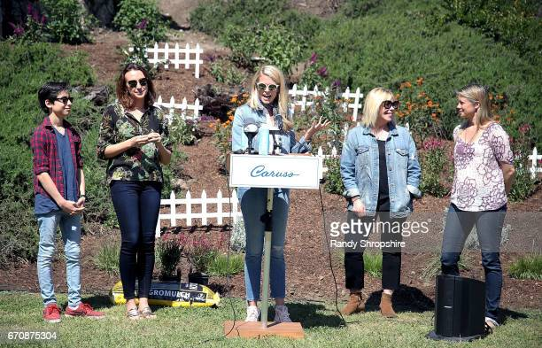 Aidan Gallagher Anna Schafer Sarah Wright Olsen president/CEO of EMA Debbie Levin and Amy Smart attend Caruso hosts a community garden in honor of...