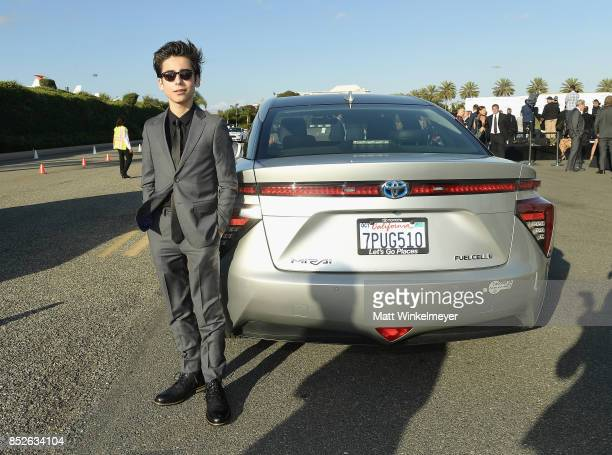Aidan Gallagher poses with the Toyora Mirai the zero emissions car during the 2017 EMA Awards Presented by Toyota on September 23 2017 in Santa...