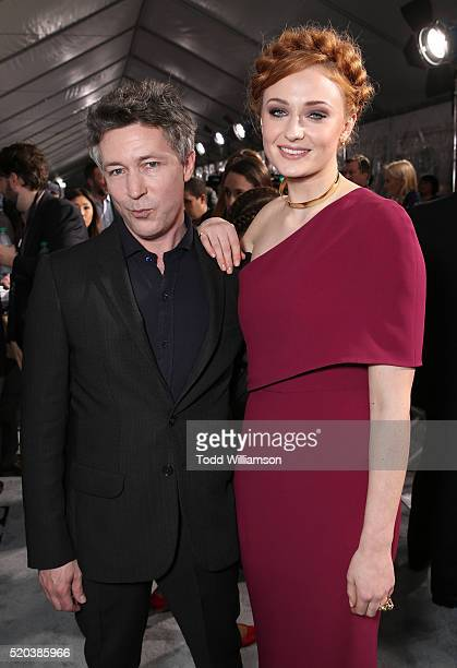 Aidan Gillen and Sophie Turner attend the premiere of HBO's 'Game Of Thrones' Season 6 at TCL Chinese Theatre on April 10 2016 in Hollywood California