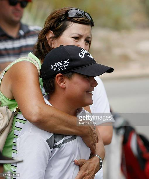 Aidan Goldstein gets a hug from mom Kerri in celeration of his overall win in the Boy's 1011 year old Division during a regional round of the Drive...