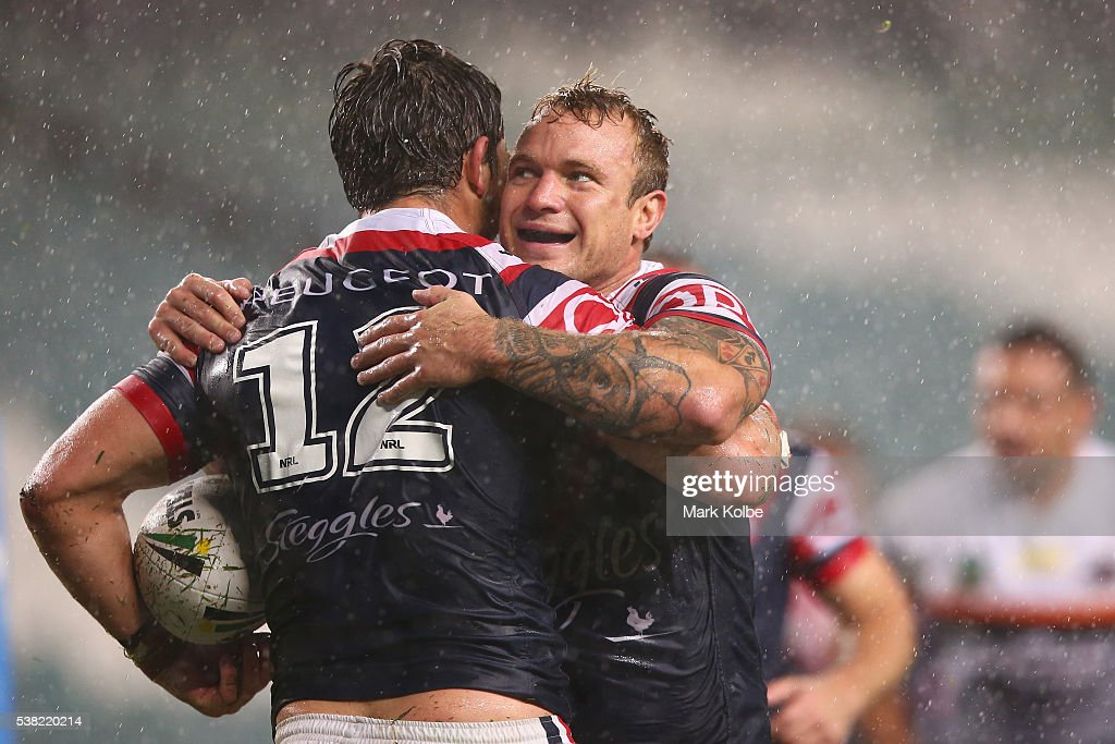 Aidan Guerra and Jake Friend of the Roosters celebrate a try during the round 13 NRL match between the Sydney Roosters and the Wests Tigers at Allianz Stadium on June 5, 2016 in Sydney, Australia.