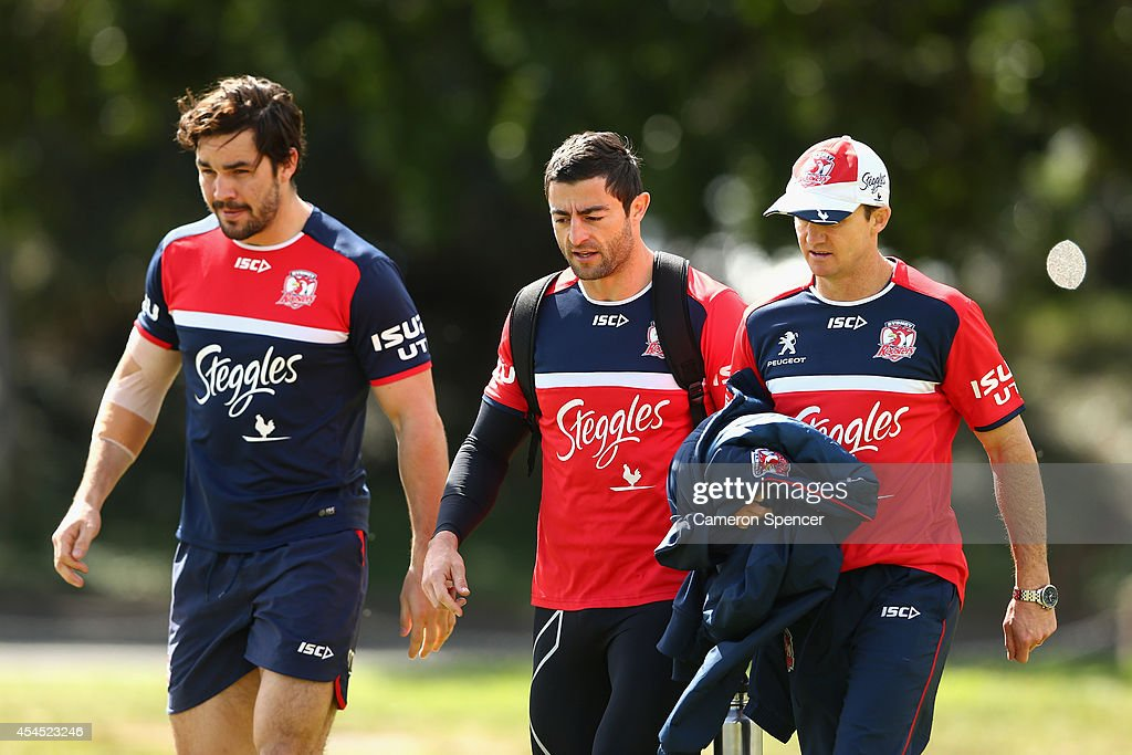 Aidan Guerra, <a gi-track='captionPersonalityLinkClicked' href=/galleries/search?phrase=Anthony+Minichiello&family=editorial&specificpeople=211500 ng-click='$event.stopPropagation()'>Anthony Minichiello</a> of the Roosters and Roosters assistant Jason Taylor talk during a Sydney Roosters NRL training session at Kippax Lake on September 3, 2014 in Sydney, Australia.