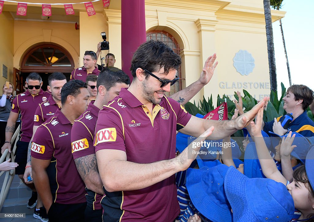 Aidan Guerra high fives young fans during a Queensland Maroons State of Origin Fan Day on June 14, 2016 in Gladstone, Australia.