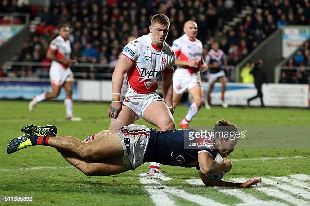 Aidan Guerra of Sydney Roosters goes over for a try during the World Club Series match between St Helens and Sydney Roosters at Langtree Park on...