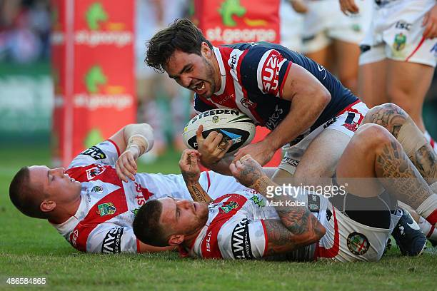 Aidan Guerra of the Roosters celebrates scoring a try during the round 8 NRL match between the St George Illawarra Dragons and the Sydney Roosters at...