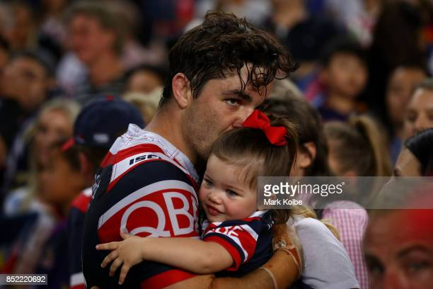 Aidan Guerra of the Roosters hugs his family after defeat during the NRL Preliminary Final match between the Sydney Roosters and the North Queensland...