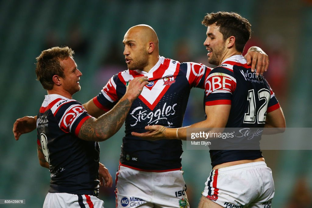 Aidan Guerra (R) of the Roosters is congratulated by Blake Ferguson (C) and Jakob Friend of the Roosters after scoring a try during the round 24 NRL match between the Sydney Roosters and the Wests Tigers at Allianz Stadium on August 19, 2017 in Sydney, Australia.
