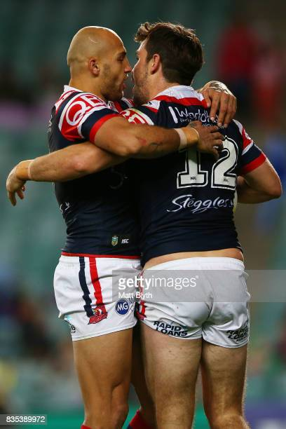 Aidan Guerra of the Roosters is congratulated by Blake Ferguson of the Roosters after scoring a try during the round 24 NRL match between the Sydney...