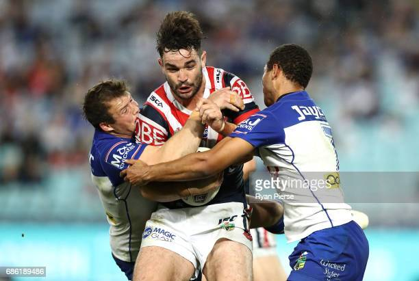 Aidan Guerra of the Roosters is tackled by Josh Morris of the Bulldogs during the round 11 NRL match between the Canterbury Bulldogs and the Sydney...