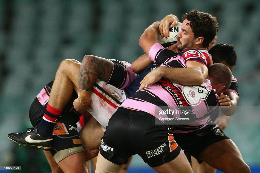Aidan Guerra of the Roosters is tackled during the round nine NRL match between the Sydney Roosters and the Wests Tigers at Allianz Stadium on May 9, 2014 in Sydney, Australia.