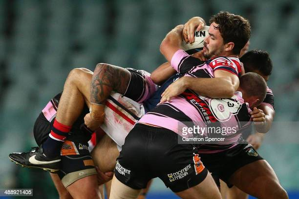 Aidan Guerra of the Roosters is tackled during the round nine NRL match between the Sydney Roosters and the Wests Tigers at Allianz Stadium on May 9...