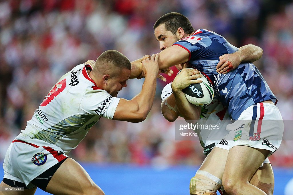 Aidan Guerra of the Roosters is tackled during the round seven NRL match between the Sydney Roosters and the St George Illawarra Dragons at Allianz Stadium on April 25, 2013 in Sydney, Australia.