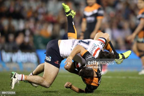 Aidan Guerra of the Roosters picks up and tackles Jack Littlejohn of the Tigers during the round 14 NRL match between between the Wests Tigers and...