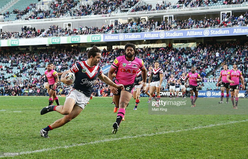 Aidan Guerra of the Roosters scores a try during the round 19 NRL match between the Sydney Roosters and the Penrith Panthers at Allianz Stadium on July 19, 2014 in Sydney, Australia.