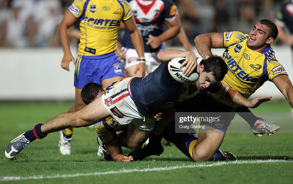 Aidan Guerra of the Roosters scores during the NRL trial match between the Sydney Roosters and the Parramatta Eels at Bluetongue Stadium on February 27, 2010 in Gosford, Australia.