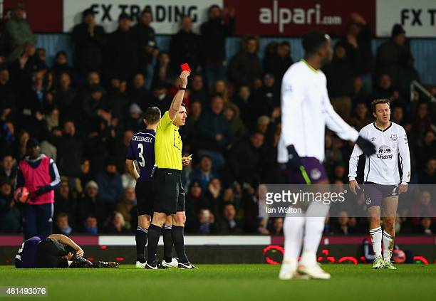 Aidan McGeady of Everton is shown a red card and is sent off by referee Neil Swarbrick after a challenge on Mark Noble of West Ham United during the...