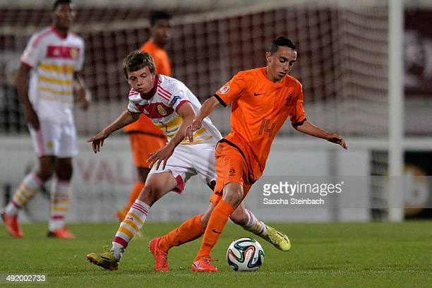 Aidan Nesbitt of Scotland vies with Abdelhak Nouri of Netherlands during the UEFA Under17 European Championship 2014 semi final match between...