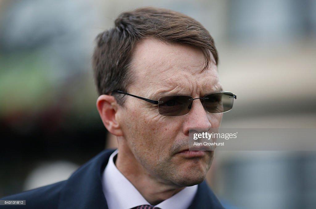 Aidan O'Brien poses at Curragh Racecourse on June 26, 2016 in Kildare, Ireland.