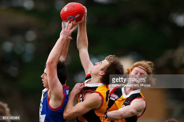 Aidan Quigley of the Power and Campbell Hustwaite of the Stingrays contest the ball during the round 14 TAC Cup match between Dandenong and Gippsland...