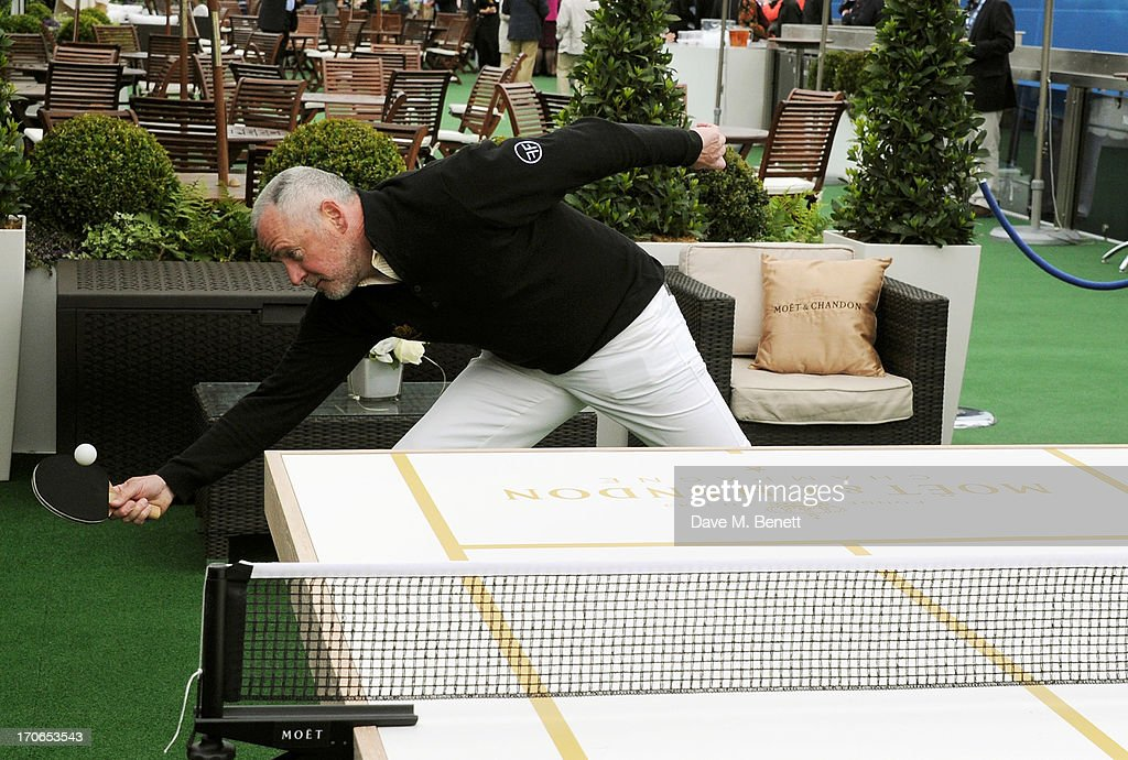 Aidan Quinn plays table tennis at The Moet & Chandon Suite at The Aegon Championships Queens Club finals on June 16, 2013 in London, England.