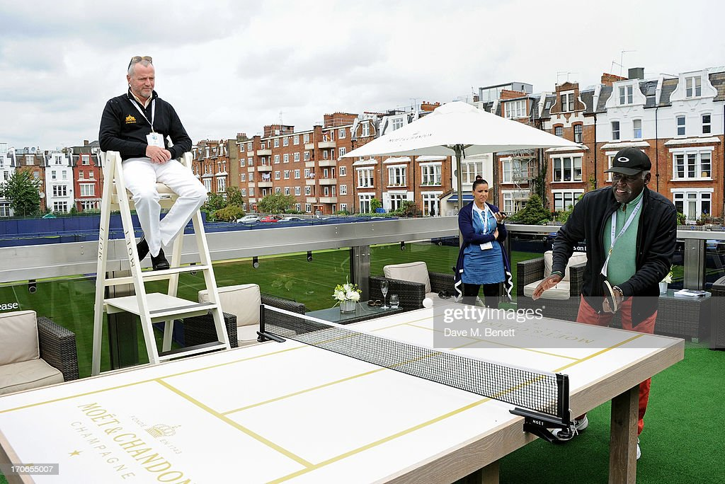 Aidan Quinn umpires as Richard Roundtree plays table tennis at The Moet & Chandon Suite at The Aegon Championships Queens Club finals on June 16, 2013 in London, England.