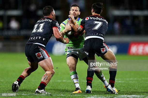 Aidan Sezer of the Raiders is tackled by Bodene Thompson and Shaun Johnson of the Warriors during the round 11 NRL match between the New Zealand...