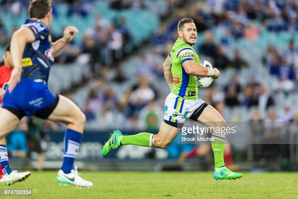 Aidan Sezer of the Raiders runs the ball during the round nine NRL match between the Canterbury Bulldogs and the Canberra Raiders at ANZ Stadium on...