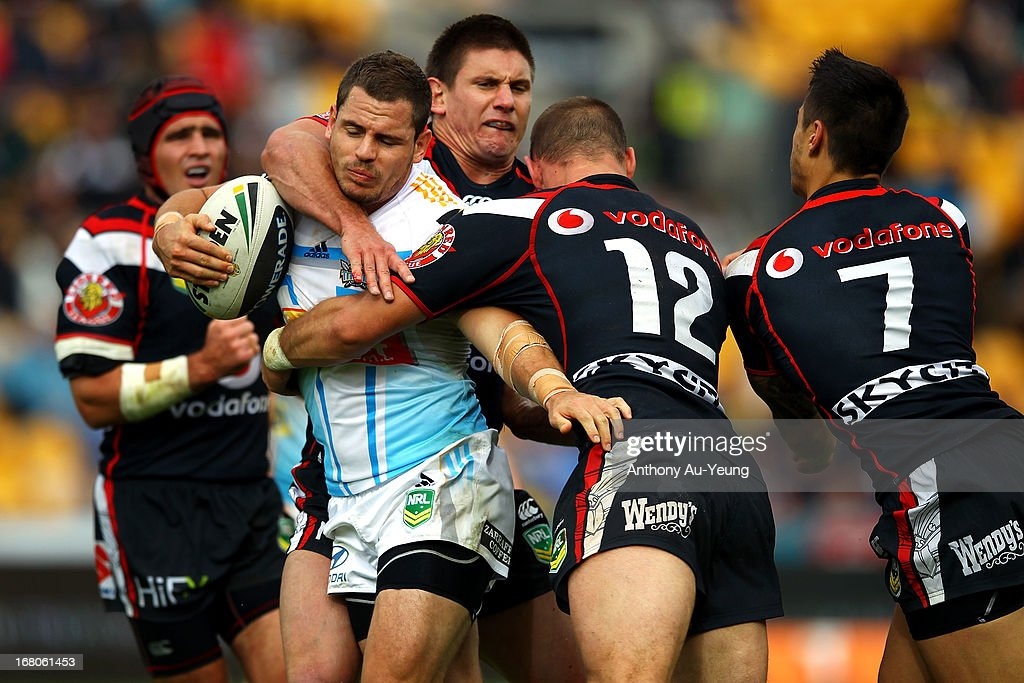 Aidan Sezer of the Titans is tackled by Simon Mannering and Jacob Lillyman of the Warriors during the round eight NRL match between the New Zealand Warriors and the Gold Coast Titans at Mt Smart Stadium on May 5, 2013 in Auckland, New Zealand.