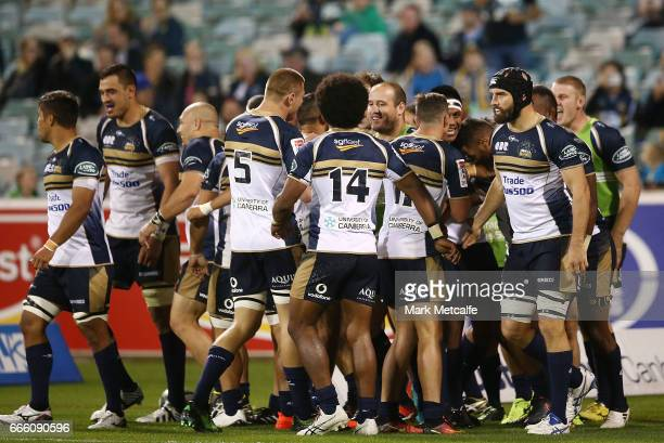 Aidan Toua of the Brumbies celebrates scoring a try with team mates during the round seven Super Rugby match between the Brumbies and the Reds at GIO...