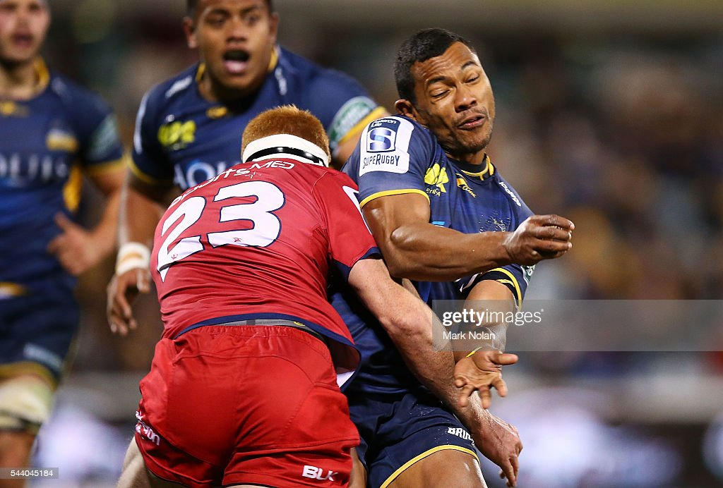 Aidan Toua of the Brumbies is tackled after passing during the round 15 Super Rugby match between the Brumbies and the Reds at GIO Stadium on July 1, 2016 in Canberra, Australia.
