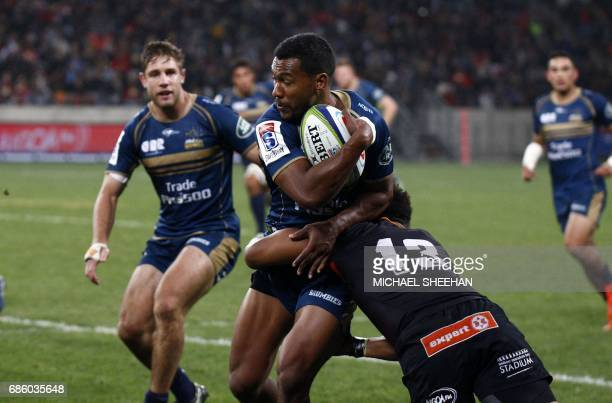 Aidan Toua of the Brumbies is tackled by Berton Klaasen of the Southern Kings during the Super Rugby match between the Southern Kings and Brumbies at...