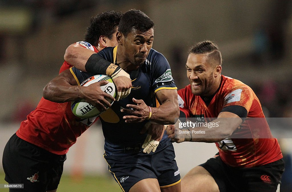 Aidan Toua of the Brumbies is tackled during the round 14 Super Rugby match between the Brumbies and the Sunwolves at GIO Stadium on May 28, 2016 in Canberra, Australia.