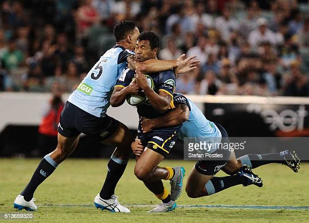 Aidan Toua of the Brumbies is tackled during the round two NRL match between the Brumbies and the Waratahs at GIO Stadium on March 4 2016 in Canberra...