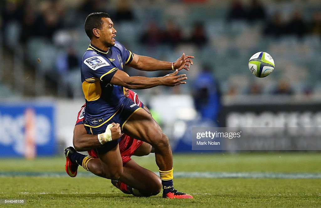 Aidan Toua of the Brumbies offloads during the round 15 Super Rugby match between the Brumbies and the Reds at GIO Stadium on July 1, 2016 in Canberra, Australia.